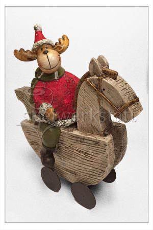Weihnachtsdeko Elch auf Schaukelpferd