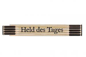"""Zollstock für Dich """"Held des Tages"""" ist ein Meterstab aus flexiblem Glasbirkenholz. Meterstab mit gut ablesbarer Skala als Klassiker der Männergeschenke."""